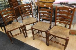 A set of four wicker seat chairs, with ladder backs