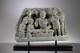A RELIEF DEPICTING BUDDHA AND FOLLOWERS