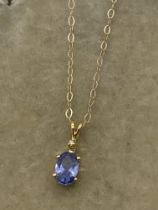 9ct GOLD TANZANITE & DIAMOND PENDANT & CHAIN
