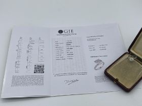 2.63ct DIAMOND SOLITAIRE WITH 0.50ct DIAMOND ACCENTS WITH VALUATION FOR £18450.00