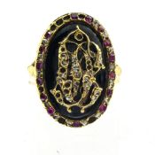 Mourning ring 18 kt yellow gold, set with interspersed rubies and diamonds forming the letters C and