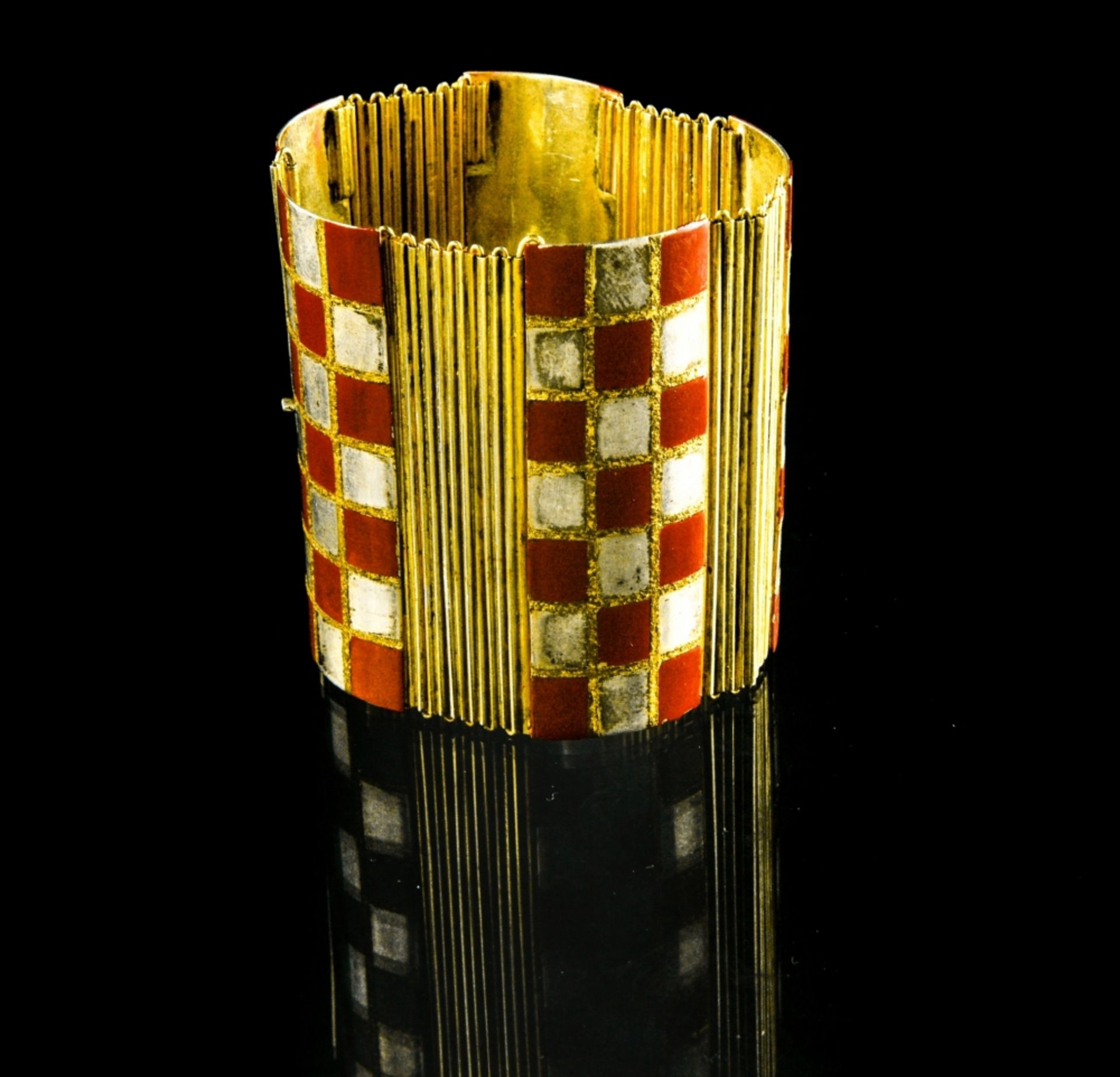 Jean DUNAND (1877 - 1942) Articulated bracelet, ca. 1922 Sterling silver, gilt metal, and red and