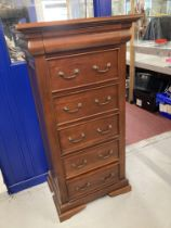 20th cent. Hardwood chest of five drawers plus one concealed glove drawer. 26ins. x 18ins. x 51½