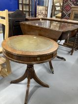 20th cent. Mahogany oval drop leaf table, two drawers beneath and quad supports with brass