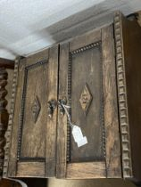 20th cent. Oak wall mounted cupboard, with applied beaded and diamond shaped mouldings. 20ins. x