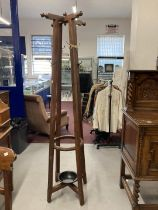 Aesthetic style rosewood hall/coat stand with cruciform hat peg top. Height 73½ins.