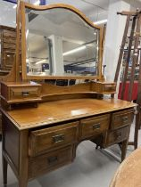20th cent. Mahogany dressing table on tapering supports. 53ins. x 67ins. x 20ins.