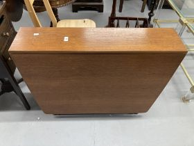 1970s teak drop leaf table, retailed by McIntosh. 59ins. x 36ins extended. 8½ins. x 36ins stowed.