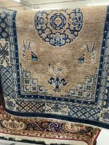 Carpets & Rugs: 20th cent. Chinese style rug, fawn ground decorated with Chinese symbols, three