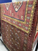 Carpets/Rugs: 20th cent. Red ground rug. 47ins. x 71ins. Plus one other maroon ground. 40ins. x