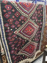 Rugs: 20th cent. Eastern black ground runner with geometric decoration. Approx. 38ins. x 78ins.