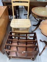 20th cent. Beech metamorphic library chair step, plus mahogany four partition Canterbury. (2)
