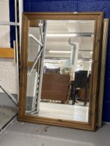 20th cent. Bevel edged decorative mirrors x 2. 29ins. x 41½ins. and 27ins. x 38ins.
