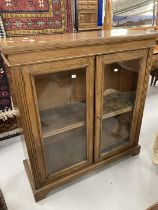 19th cent. Oak bookcase, glazed doors on bracket base. 31ins. x 15ins. x 43ins.