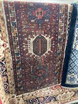 Carpets & Rugs: 20th cent. Bokhara runner, red ground, five guls with geometric pattern, three