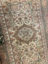 Carpets & Textiles: 20th cent. Beige ground with large central floral gul. Five borders all with