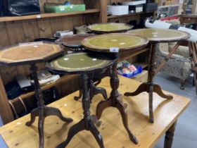 20th cent. Circular wine tables, some with leather inserts. (6)
