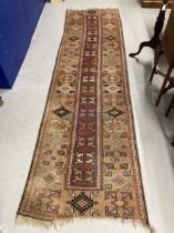 Carpets & Rugs: 19th cent. Turkaman runner, geometric designs on beige ground with reds, blues,