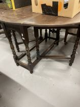 19th cent. Oak drop leaf tables, one with carved top. (2)