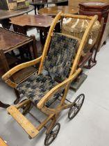 Early 20th cent. Beech framed children's pushchair.