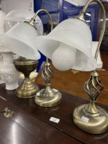 20th cent. Pair of metal lamps, a brass lamp, and a pair Blanc de Chine pottery lamps.