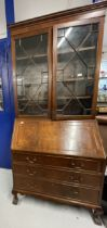 20th cent. Mahogany bureau bookcase with glazed top section, the whole supported on ball and claw