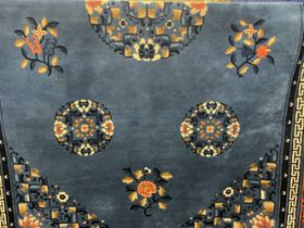 Carpets & Rugs: 20th cent. Chinese carpet, blue ground with floral/botanical decorations. Three