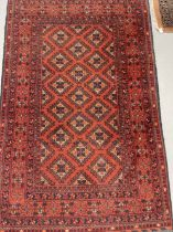 Carpets & Rugs: 20th cent. Turkman woolen carpet, red ground, six borders, geometric stylised