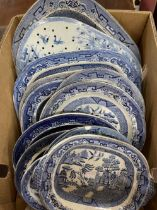 19th cent. Pottery: Blue and white willow pattern plates and a blue and white strainer. A/F.