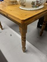 20th cent. Pine kitchen table with one central drawer, on turned supports. 47ins. x 31½ins.