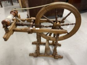 Oak framed pre-war fire screen, together with 19th cent. Beech wool spinning wheel. 30ins. x