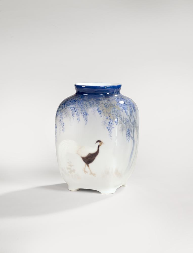 ANNA SMIDTH (1861-1953) A ROYAL COPENHAGEN PORCELAIN VASE DECORATED WITH WADING BIRDS AND A WISTERIA