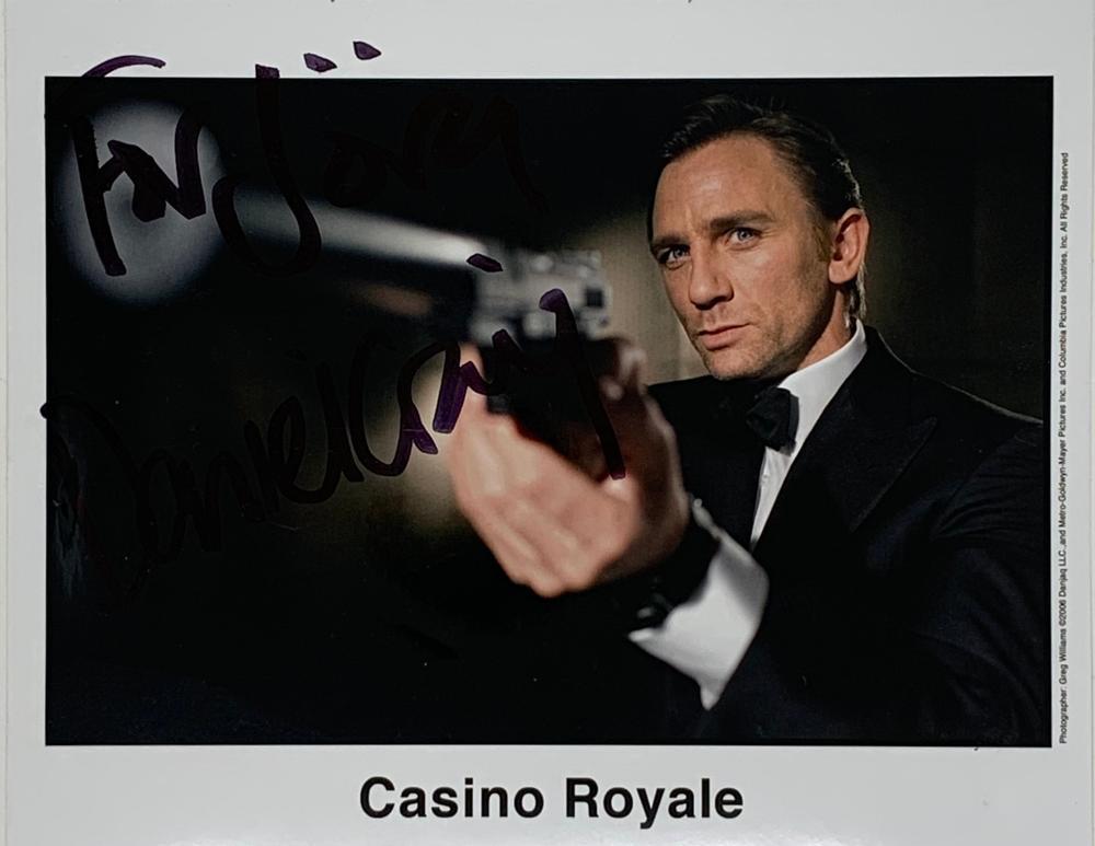 DANIEL CRAIG (B. 1968)Autographed photograph, dedicated and signed Colour photograph showing Craig