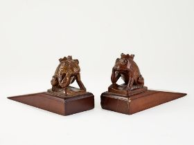PAIR OF CARVED WOOD FROG DOOR WEDGES probably mahogany lenght: 18 cm height: circa 10 cm