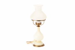 AN OIL LAMP STYLE TABLE LAMP
