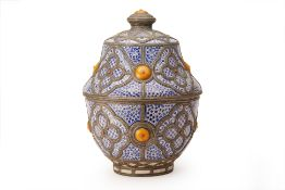 A LARGE METAL-MOUNTED MOROCCAN POTTERY JAR AND COVER