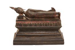 A LARGE SOUTHEAST ASIAN BRONZE FIGURE OF A RECLINING BUDDHA
