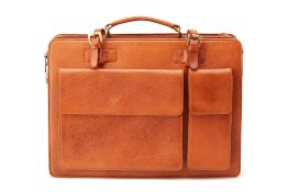 A CHESTNUT BROWN LEATHER BRIEFCASE