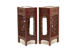 A PAIR OF TALL CHINESE CARVED SIDE TABLES