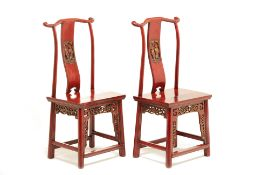 A PAIR OF CHINESE RED PAINTED CHAIRS