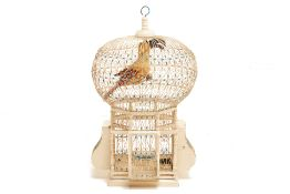 A DECORATIVE WHITE PAINTED BIRD CAGE