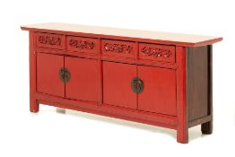 A CHINESE RED LACQUER SIDEBOARD