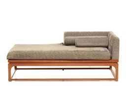 A CHAISE LONGUE UPHOLSTERED IN JIM THOMPSON FABRIC