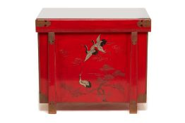 A JAPANESE RED LACQUER CHEST DECORATED WITH CRANES