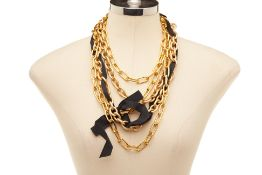 A GOLD TONE MULTI-CHAIN NECKLACE