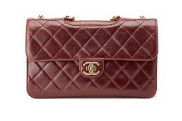 A CHANEL VINTAGE OX BLOOD DOUBLE FLAP BAG