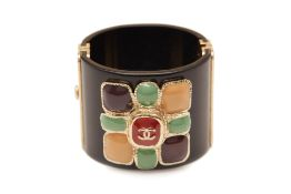 A CHANEL BLACK CUFF WITH MULTICOLOUR STONE FLOWER