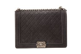A CHANEL LARGE BOY CAVIAR BAG