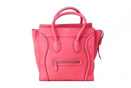 A CELINE 'MINI LUGGAGE' NEON PINK HANDBAG