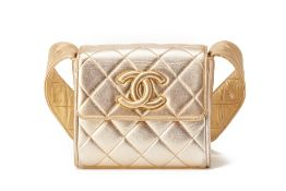 A CHANEL SMALL GOLD QUILTED FLAP CROSS-BODY BAG
